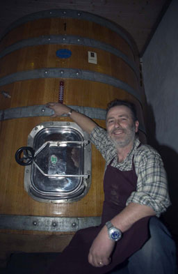 "Roberto shows off the vat for his ""Impetus"" barbera double selection"